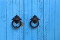 Blue wooden door with round handles bright Royalty Free Stock Photography