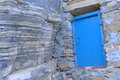 Blue wooden door simple among the rocks and stone wall of monastery of panagia hozoviotissa amorgos island greece Stock Images