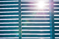 Blue wooden lath with lens flare strong sun Royalty Free Stock Image