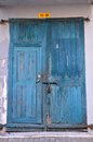 Blue wooden weathered door with padlock Royalty Free Stock Photo