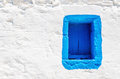 Blue wooden window on white stone wall, Greece Royalty Free Stock Photo