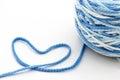 Blue of woollen thread heart on white background Stock Photos