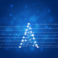Blue xmas abstract star tree background with stars bokeh and glitter lights Stock Photography
