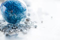 Blue xmas ornaments on bright holiday background Royalty Free Stock Photo