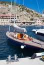 Blue yacht in berth balaklava bay famous foreland on south shore of crimea resort ukraine Stock Photography