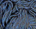 Blue yarn weave closeup textured background Royalty Free Stock Images