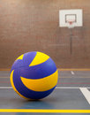 Blue and yellow ball on blue court at break time school gym Stock Photography