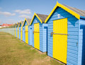 Blue and yellow beach huts Royalty Free Stock Image