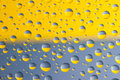 Blue and yellow drops water on the glass above ukrainian flag Stock Photo