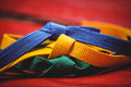 Blue, yellow and green karate belt Royalty Free Stock Photo
