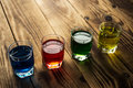 Blue yellow green red alcohol shot drinks Royalty Free Stock Photo