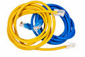 Blue and yellow patch cords. Stock Photos