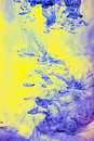 Blue and yellow pigments in water Royalty Free Stock Photos
