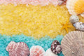 Blue yellow pink bath salt and seashells Stock Photo