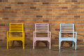 Blue yellow and pink wooden chair Royalty Free Stock Photo