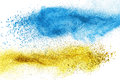 Blue and yellow powder explosion isolated Royalty Free Stock Photo