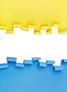 Blue and yellow ripped paper background curled in isolated over white Royalty Free Stock Photography
