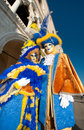 Blue and yellow venice mask couple Royalty Free Stock Images