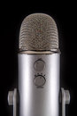 Blue yeti podcast condenser microphone isolated on black Stock Photo