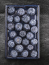 Blueberries on blue plate on gray old wooden table top view Stock Image