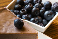 Blueberries cheesecake over a wooden table Royalty Free Stock Photos