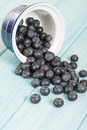 Blueberries delicious juicy on a blue wooden table Royalty Free Stock Images