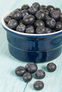 Blueberries delicious juicy on a blue wooden table Royalty Free Stock Photo