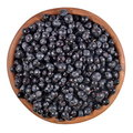Blueberries fruit in a wooden bowl on a white background Royalty Free Stock Photos