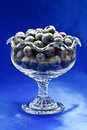 Blueberries in glass dessert bowl closeup of ripe with studio background Stock Images