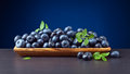 Blueberries with green leaves in wooden dish Royalty Free Stock Photo