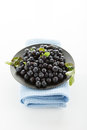 Blueberries hill ripe on a black plate on a white background Royalty Free Stock Photo