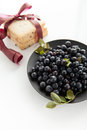 Blueberries hill ripe on a black plate on a white background Stock Photography
