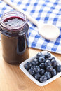 Blueberries and jam Stock Images