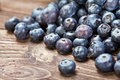 Blueberries on old wooden table background. Shallow depth of fie Stock Images