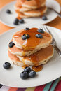 Blueberries & pancakes Stock Photos