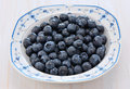 Blueberries in a pretty dish freshly washed blue and white bowl on rustic white background Royalty Free Stock Photos