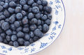 Blueberries in a pretty dish freshly washed blue and white with room for text Stock Photo