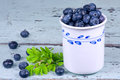 Blueberries in a white mug Stock Photography