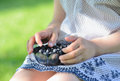 Blueberries young girl holding a bowl of Royalty Free Stock Photo