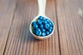 Blueberry antioxidant organic superfood in a bowl concept for healthy eating and nutrition on wooden background Stock Photos