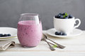 Blueberry banana smoothie in a glass Royalty Free Stock Photo