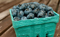 Blueberry container on the table closeup Royalty Free Stock Image