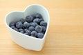 Blueberry on heart shape bowl Royalty Free Stock Photos