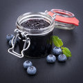 Blueberry jam fresh in a preserving glass Stock Image