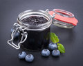 Blueberry jam fresh in a preserving glass Stock Photography