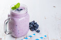 Blueberry jogurt smoothie in glass jar Royalty Free Stock Photo