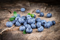 Blueberry with leaves on wood Royalty Free Stock Photo