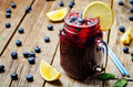 Blueberry lemonade on a dark wooden background toning selective focus Royalty Free Stock Photos
