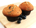 Blueberry muffins with fresh fruit on wooden board Royalty Free Stock Photography