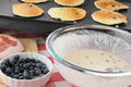 Blueberry pancakes cooking on the grill Royalty Free Stock Photo